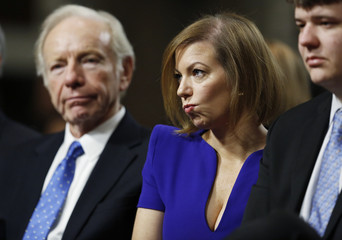Former U.S. Senator Lieberman sits with Ashton Carter family members at Senate Armed Services Committee confirmation hearing on Capitol Hill in Washington