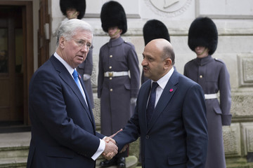 Britain's Defence Secretary Michael Fallon greets Turkish Minister of Defence Fikri Isik at the Foreign Office in London
