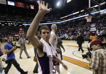 Phoenix Suns' Steve Nash waves to fans as he leaves the court in what could be his last Suns game after their NBA basketball game with the San Antonio Spurs in Phoenix