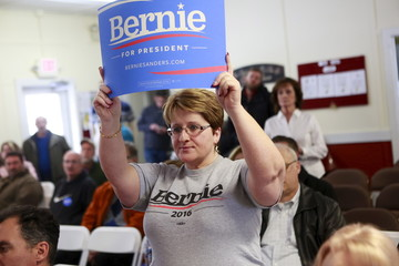 Deborah Cuenca of Derry, New Hampshire, holds up a sign in support of U.S. Democratic presidential candidate and U.S. Senator Bernie Sanders at the Londonderry Senior Center in Londonderry, New Hampshire