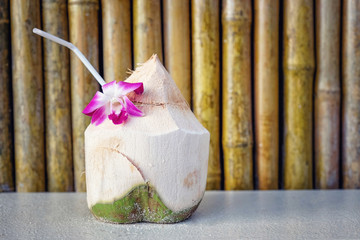 Fresh coconut water with bamboo background