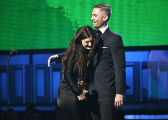 "Producer Joel Little hugs Lorde after they accepted the award for Song of the Year for Lorde's ""Royals""  at the 56th annual Grammy Awards in Los Angeles"