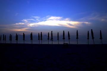silhouettes on beach at sunrise