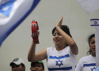 A protester plays a tambourine during a demonstration against Palestinians' U.N. bid for statehood, in Guatemala City