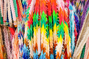 Colorful paper birds hanging together. Texture of Origami crane in lines.