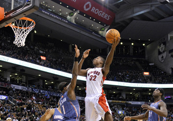 Raptors forward Ed Davis goes to the basket against Charlotte Bobcats guard Stephen Jackson during their NBA basketball game in Toronto
