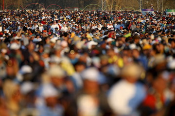 People attend the Mass celebrated by Pope Francis in Ciudad Juarez, Mexico
