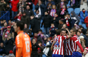 Atletico Madrid's Godin celebrates his goal against Real Valladolid  with teammates during their Spanish First Division soccer match in Madrid