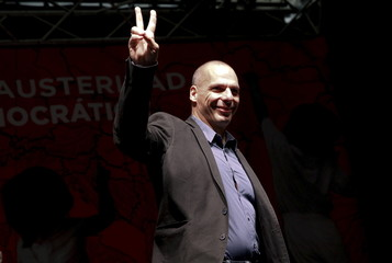 "Former Greek Fnance Minister Varoufakis gestures as he arrives to take part in the ""Plan B against austerity and for a democratic Europe"" conference in Madrid"