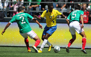 Ecuador's Ayovi goes for the ball against Mexico's Rodriguez and Osorio during the first period of their Federacion Ecuatoriana De Futbol (FEF) match at Qwest Field, Seattle
