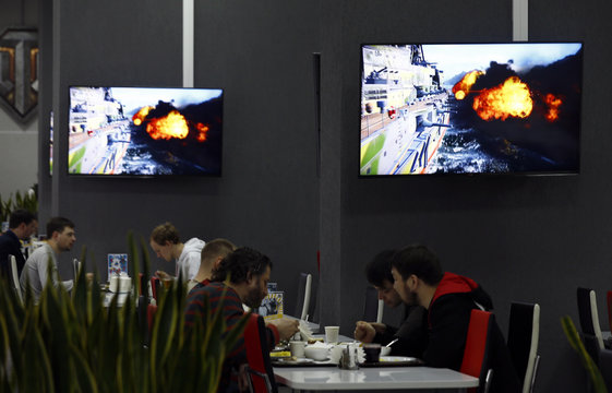 Employees have their lunch in a cafe of Wargaming's branch Game Stream company in Minsk