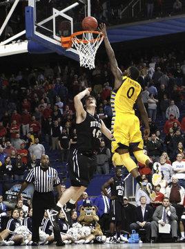 Marquette University's Wilson blocks shot of Butler University's Smith during NCAA basketball game in Lexington