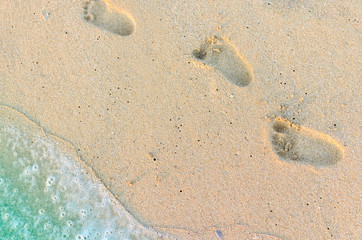 Footprints of baby on the sand