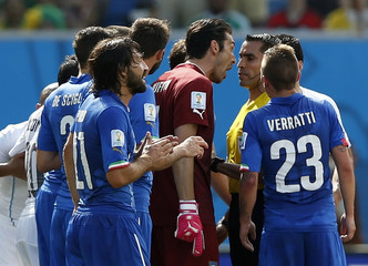 Italy's Buffon argues with referee Rodriguez of Mexico after he showed red card to Italy's Marchisio during their 2014 World Cup Group D soccer match against Uruguay at the Dunas arena in Natal