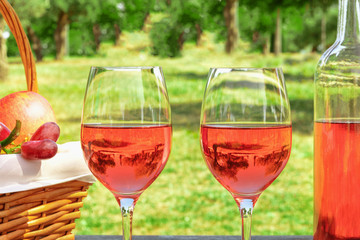 Two glasses of rose wine at picnic with copyspace