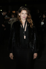 French actress and former fashion model Laetitia Casta poses before the Givenchy Fall/Winter 2014-2015 women's ready-to-wear collection show during Paris Fashion