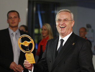 Volkswagen CEO Winterkorn poses for photographers as he arrives on the red carpet in Berlin
