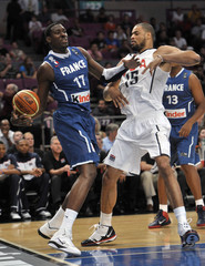France's Mahinmi tries to pass past USA's Chandler in their international exhibition basketball game in New York