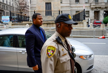 Officer William Porter, one of six officers charged in connection with the death of Freddie Gray, arrives at the courthouse in Baltimore