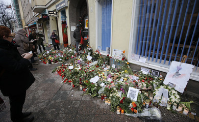 Flowers are pictured outside the apartment house where David Bowie was living in 1976-78 in Berlin
