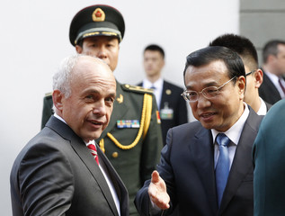 Swiss President Maurer welcomes Chinese Premier Li during the second day of an official visit to Switzerland in Bern