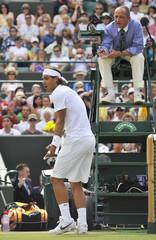 Spain's Rafael Nadal argues with the chair umpire during his match against Sweden's Robin Soderling at the 2010 Wimbledon tennis championships in London