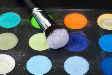 Eye shadow palette in natural colours and makeup brushes