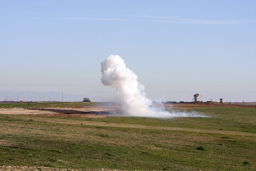 Smoke rises during clashes between Kurdish Peshmerga fighters and Islamic State militants on the outskirts of Mosul