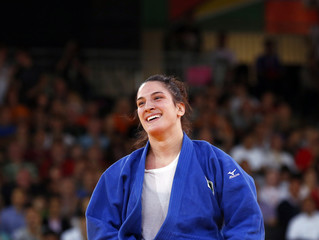 Brazil's Mayra Aguiar celebrates after defeating Netherlands' Marhinde Verkerk in women's -78kg bronze medal judo match at London 2012 Olympic Games