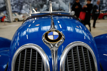 A vintage BMW is pictures before a news conference marking the companies 100th birthday festivities in Munich