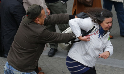 Pro-government supporter scuffles with an anti-government supporter near a ceremony marking the 60th anniversary of 1956 anti-Communist uprising in Budapest