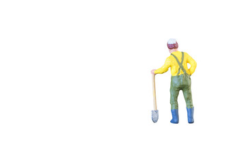 Close up of Miniature farmer people isolated with clipping path on white background . Elegant Design with copy space for placement your text, mock up for farmer and gradening concept