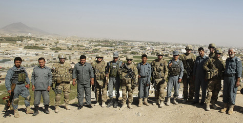 U.S. army soldiers of Task Force Lancer, 484th Military Police Company, stand side by side with Afghan policemen in the outskirts of Kandahar city