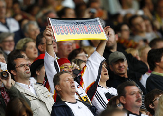 Supporters cheer for Germany's women's national soccer team during their international soccer friendly against Norway in Mainz