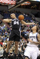 San Antonio Spurs Jefferson dunks ball in front of Minnesota Timberwolves Beasley during the first half of their NBA basketball game at Target Center in Minneapolis