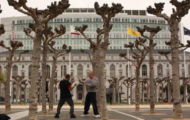 Men practice martial arts at Civic Center Plaza in San Francisco