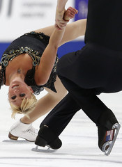 Denney and Coughlin of the U.S. perform during the pairs short program at the ISU Grand Prix of Figure Skating Rostelecom Cup in Moscow