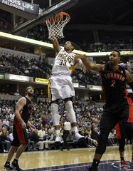 Indiana Pacers' forward Granger scores as Toronto Raptors' center Gray and forward Johnson watch during the fourth quarter of their NBA basketball game in Indianapolis