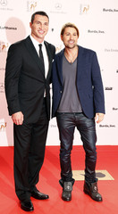 Boxer Klitschko and violinist Garrett arrive on red carpet for Bambi 2013 media awards ceremony in Berlin