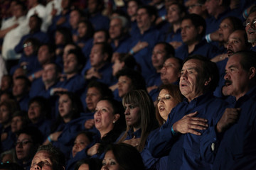 People sing national anthem before presidential inauguration of Perez Molina in Guatemala City