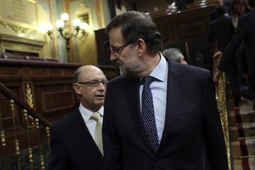Spain's PM Rajoy and Treasury Minister Montoro arrive for the 2014 budget debate at Parliament in Madrid