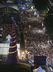 Thousands of South Koreans demonstrate demanding an apology from South Korean President Park to take responsibility for a spy agency scandal, reform of the national spy agency and organize a special prosecution team to investigate the scandal, in Seoul