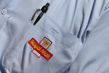 A  logo is seen on the shirt pocket of a postal worker during a protest against the privatisation of the Royal Mail, outside their headquarters in London
