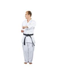 Sportsman is training formal exercises of karate