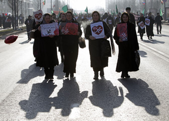 Women attend a rally to protest against satirical cartoons of prophet Mohammad, in Grozny, Chechnya