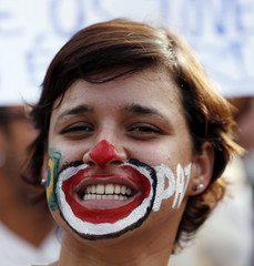 A demonstrator with his face painted like a clown shouts slogans during a protest against the Confederations Cup and President Rousseff's government in Recife