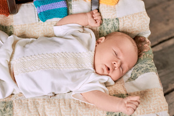 Infant with eyes closed. Small caucasian kid. Baby sleeping time.