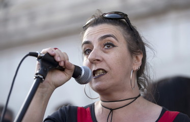 Prentoulis from the Greek radical leftist party Syriza speaks as demonstrators gather to protest in London