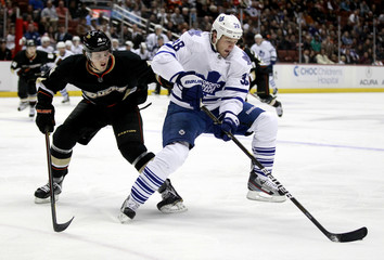 Leafs' Rosehill controls the puck in front of Ducks' Fowler during the first period of their NHL hockey game in Anaheim