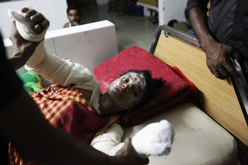 One of the survivors of a fire that sparked in Old Dhaka lies on a bed at the Medical College Hospital in Dhaka